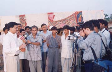 President (Mr.Mathurbhai Savani) been interviewed by television reporter.